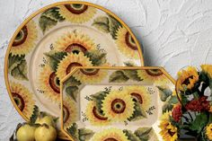 """""""Alentejo Sunflowers"""" by Casafina is a fresh sunny pattern from the province of Alentejo in Portugal. This terracotta dinnerware is hand-painted and made in a food safe glaze, meaning it can be used for both decorating and food serving! These colors are sure to brighten anyone's day!"""