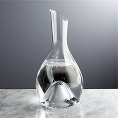 Our graceful modern carafe is handmade by a team of European master artisans with an angle-cut neck for the perfect pour. Concave base provides a hand-hold and maximizes surface exposure when decanting wines. Carafe, Modern Decanters, Wine Dispenser, Champagne Buckets, Expensive Wine, Glass Molds, Wine Charms, Wine Decanter, Crate And Barrel
