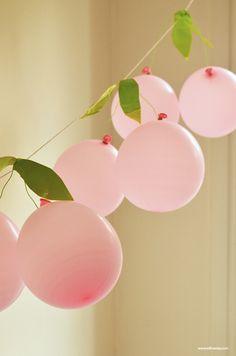 Cute DIY cherry balloon garland for a party.