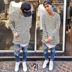 Jaii'C on IG. Skinny ripped jeans. Adidas superstar pharrel williams editiom. black and white stripped long fit shirt. grey long fit shirt. snapback.