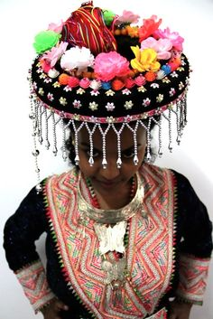 Asia | Portrait of a Hmong girl wearing traditional clothes and headdress #embroidery #beads #Miao