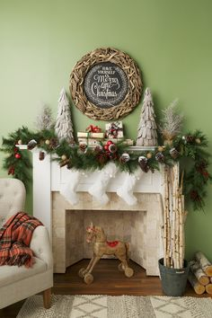 room 100 current and traditional ideas for your christmas fireplace find this pin and more on holiday decorating by homegoods