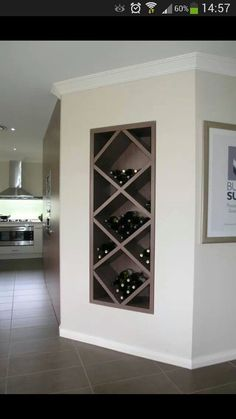 Clever wine rack - could put in fire place if kept one at rear. Maybe have this above reinstalling a fire place. Alternative place would be at turn of living room wall and extension.