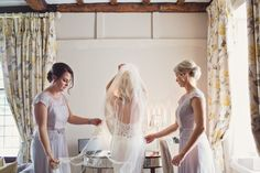 Bride getting ready for her wedding at Laura Ashley Manor in Hertfordshire