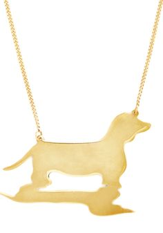 Doxie Moxie Necklace. When youre far from your best animal friend, donning this darling dachshund necklace by And Mary always makes you smile!  #modcloth