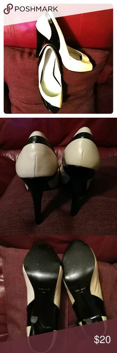 NINE WEST PUMPS This beautiful 5 in. Heels is of mix materials. The black is Patten leather and the cream color is genuine leather. Worn once. There are a few minor imperfections. Please see pics. Nine West Shoes Heels
