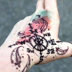 http://tattoomagz.com/blacks-compass-tattoos-on-arms/colorful-feather-and-compass-tattoo-on-arm/