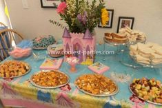 The food and snack table: My daughter Natalie loves Disney Princess' so when it came time to plan her 4th birthday party there was no doubt on what she wanted.   For our invitations