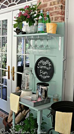 After finding a door at a thrift shop for $5, blogger Christy was inspired to give it new life as an outdoor beverage station by sanding it down and painting it. To prepare it for entertaining, she added two shelves—the first is attached to a wine glass holder and the second has legs so that it could stand on its own.