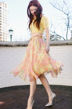 Romantic Dressing @ Sea of Shoes: Pastel yellow and coral look with cropped short sleeve cardigan and feminine and flowy layered chiffon skirt.