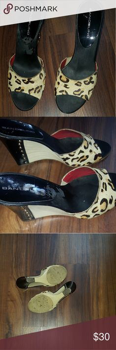Bandolion animal print wedges with gold studs Bandolion animal print wedges with gold studs on heels / 4inches size 7 , nice wear for Sunday brunch! Bandolion Shoes Wedges