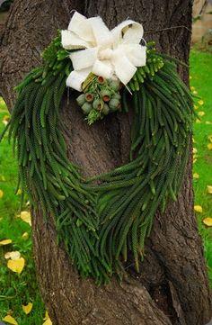 evergreen wreath with acorn corsage. botanicalbrouhaha.com