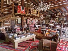 COLORADO SALOON In the adjacent saloon, a vintage English club chair and a sofa covered in a Ralph Lauren Home leather are grouped with a bespoke cocktail table atop antique Navajo rugs. Madison Avenue, Colorado Ranch, Colorado House, Guest Cabin, Cozy Cabin, New York Homes, Ralph Lauren Style, Lodge Style, Western Homes
