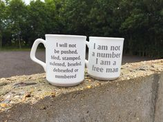 """Coffee time for Cult TV fans: A couple of my old and now distinctly foxed coffee mugs from The Prisoner shop that used to be at Portmeirion. What's that big white balloon coming over the hill? """"No... get back Rover!"""""""