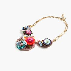 The rainbow of blooming iridescent sequins and crystals on this necklace is hands down the prettiest (and easiest) way to remind your T-shirt and jeans just how fancy they can be. Brass, acetate, glass, epoxy stone, sequins