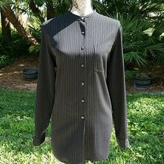 🌹HP🌹 Lord and Taylor Tunic Button down Black and white stripe tunic, 30 in long. The bust measures 22in. 95 poly 5rayon Lord & Taylor Tops Tunics