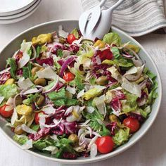 Part green salad, part #antipasto salad, this recipe combines lettuce, celery, onion, peperoncini, olives and cherry tomatoes -- all tossed in a simple #homemade dressing made with olive oil, vinegar and a little mayonnaise.