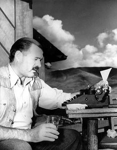 Ernest Hemingway is shown at his typewriter as he works on For Whom the Bell Tolls at Sun Valley lodge, Idaho, in 1939.