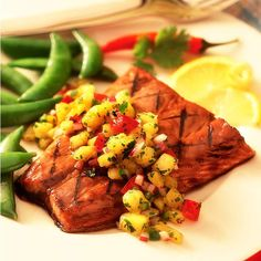 A simple splash of Lawry's® Hawaiian Marinade will bring new flavors to your family dinner. It adds sweet and tangy flavor to grilled salmon and the fresh pineapple salsa topping.
