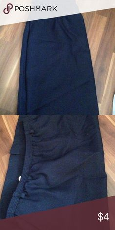 Blue midi skirts Purchased at a thrift store but never worn. Stretch waist with belt loops and pockets simple blue skirt. Perfect simple staple piece for anyones closet classic collection Skirts Midi