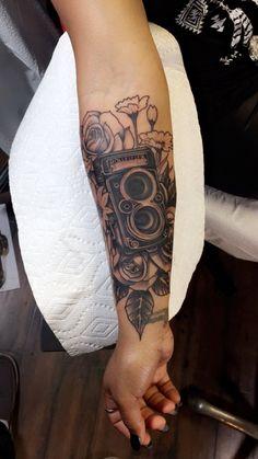 Rolleiflex camera tattoo by Kyle Wood. Vintage camera tattoo.