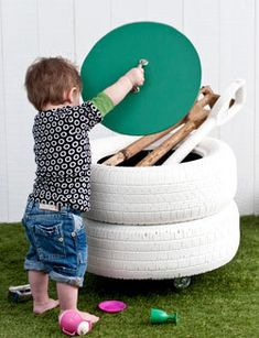 toy or storage box.  Spotted this pic today with no description whatsoever, but what a clever idea. A couple of tires secured together and mounted to a piece of plywood (I'm guessing here) with some casters attached. Another round bit of plywood (again guessing here) to serve as a lid with drawer handle attached.  A little spray paint later, and we'd be done.