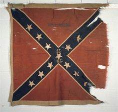 Battle flag of the 55th Regiment North Carolina state Troops. It served in Davis'/Cooke's Brigade, Heth's Division, 3rd Corps (Hill's), ANV. The 55th lost their first flag at Gettysburg on July 3rd, 1863 in front of the stone wall near the Bryan Farm. This flag was issued to the Regt. as a replacement but it was captured during the fight at the Battle of Weldon Railroad, August 19, 1864 by Pvt. Jennings, Co. K, 56th Pa. Volunteer Infantry.