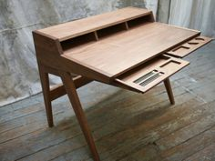 Drawing inspiration from George Nelson's swag, The Laura Desk is quite a unique piece. It's simple, functional, and modern-a flash back to the simplicity and craftsmanship of yesterday's utilitarian writing desks.