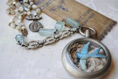 treasure-filled old watch cases make interesting one of a kind jewelry #bluebird #vintage #Jewlery