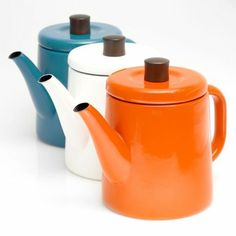 Teapots in blue, white and orange.