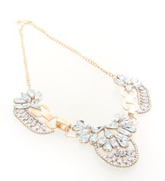 A bold statement piece designed to inspire and impress. Perfect against tube or evening dresses.