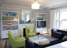 The colors of my living room are turquoise, lime green, white, and grey...this clean look, yet sophisticated inspires my own designs for my living room.