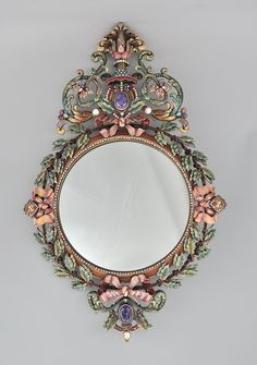 "Jay Strongwater French Baroque Style Wall Mirror inset and with polychrome enamels and colored Swarovski® crystals inset in the metal framework -  Approx. 22-3/4"" x 14-1/2"","