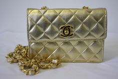 RARE Color!!! Vintage 1989-1991 CHANEL Small Gold Quilted Lambskin Leather Flap Bag with Gold CC Claps & Chain Shoulder Strap.  This bag is leather lined and includes it's dustbag!