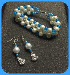 Glasparels blauw/wit oorbellen met armband