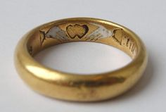 Posy ring with pictogram inscription, 'Two hands, one heart, Till death us part.' Made in England in the 17th century.