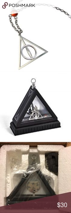 Harry Potter Deathly Hallows necklace Silver Harry Potter Deathly Hallows necklace. Rotating pendant. Comes with a display case as well. Adjustable chain (see last photo). Harry Potter Jewelry Necklaces