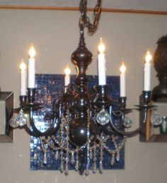 My first recycled chandelier.  I took an old brass chandelier and cleaned it up.  All it took was a can of black spray paint, some crystals by sonya