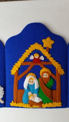 DIY photo tutorial + pattern to make the triptych with photos and clear explanation in English. This lovely triptych shows the story of the birth of Jesus Christ. In the middle part we see Mary, Joseph, and baby Jesus in his manger. The angel watches over Christmas Nativity Scene, Felt Christmas, Christmas Projects, Christmas Ornaments, Birth Of Jesus Christ, Baby Jesus, Felt Books, Three Wise Men, Felt Diy