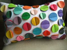 Very cute pillow. I've seen this technique used a lot lately (tacking down felt circles). I wonder how it wears.