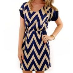 Blue and cream chevron dress, size L Super cute chevron dress that can be worn alone or with tights. Has a tie that wraps around the waist to modify your look. Short cuffed sleeve, runs a little small.                               **the first picture has long sleeves, this dress has short cuffed sleeves*** Dresses