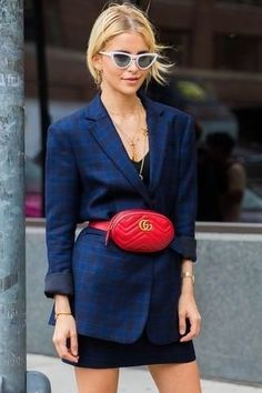 Feast your eyes on the modern menswear-inspired silhouettes that are making the classic topper ultra-chic again. Loving this blue blazer paired with a black dress and accessorized with a bright red Gucci fanny pack..