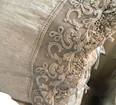 linen pillowcase with embroidered detail by Arte Pura