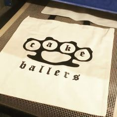 thecakeballers These bad boys are hot off the press and ready to be yours! Want to win a baller bag? Like. Share.  Good luck and brass knuckles. www.cakeballers.com #thecakeballers #cakeballers #cakeballs #weballcake #eatmorecakeballs #gotballs #brassknuckles #totes #shoplocal #boiseballers 💥thanks to @brigadewakesurfing for the dope screen print