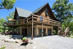 Appalachian Log Home on 10.5 acres with panoramic vistas, 1 acre pond and 2 story art studio/workshop/garage for sale in the mountains of West Virginia. http://realplanz.com/?p=3040