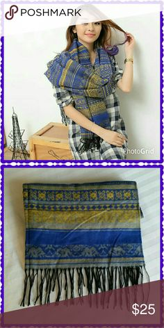 Long blue and gold wool scarf / wrap The scarf is so soft and warm. A beautiful lapis blue and gold pattern. It is nice and big measuring 72 inches by 24 inches. New in package. Boutique Chic  Accessories Scarves & Wraps