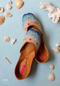 If you're planning for your next beach vacay, consider ditching those boring flip-flops for something different this time. Our 'Beach Please' juttis bring the entire shore to your feet! Shop these and more from our collection of designer juttis online. Bride Shoes, Wedding Shoes, How To Tie Shoes, Coral Sandals, Indian Shoes, Flip Flop Shoes, Flip Flops, Kawaii Accessories, Pretty Shoes