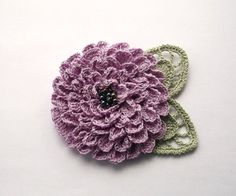 This Stunning statement that will accent any outfit.    I have made this brooch with 100% cotton thread. The flower has lots of small petals