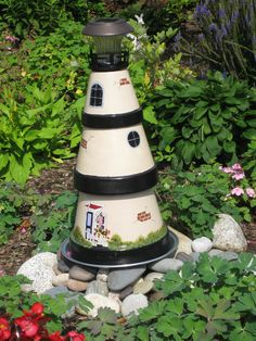 Lighthouse made of clay pots and hand painted