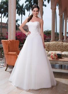 Sweetheart Gowns sweetheart style 6080 Organza, venice lace A-line dress featuring a strapless neckline.